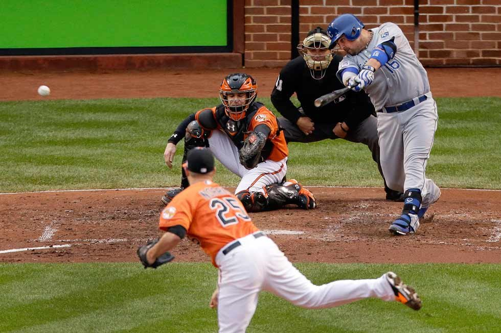 Kansas City Royals' Billy Butler hits a RBI double during the third inning of Game 2 of the American League baseball championship series against the Baltimore Orioles Saturday, Oct. 11, 2014, in Baltimore. (AP Photo/Charlie Riedel)