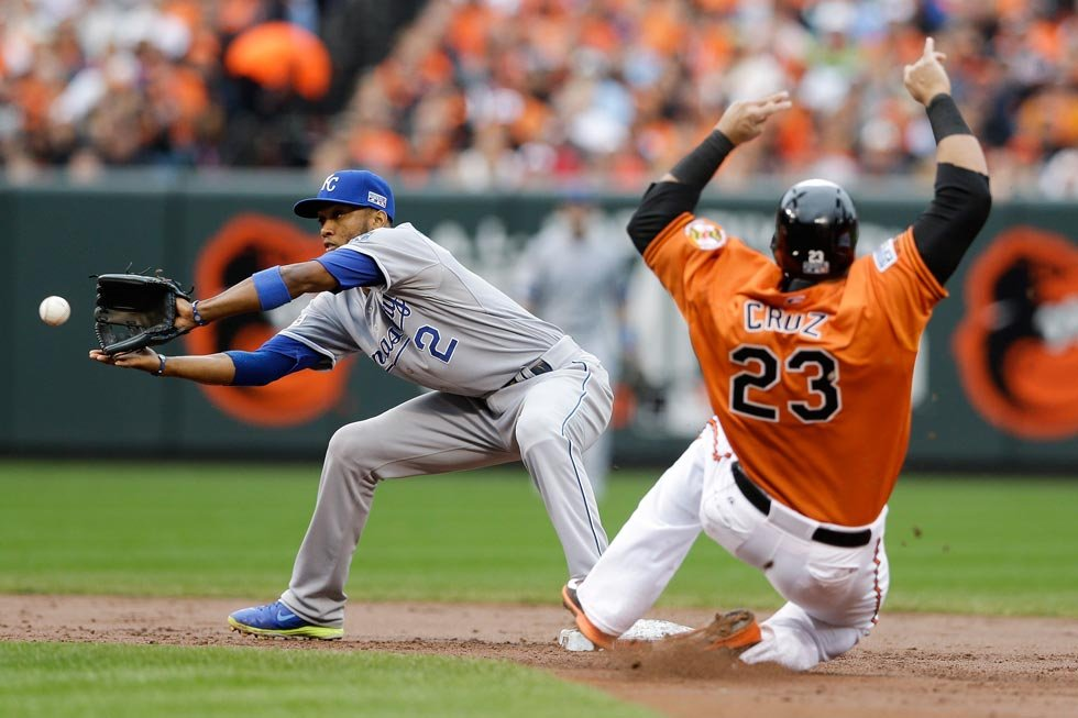 Kansas City Royals shortstop Alcides Escobar takes the throw as Baltimore Orioles' Nelson Cruz is forced out at second during the second inning of Game 2 of the American League baseball championship series Saturday, Oct. 11, 2014, in Baltimore. (AP Photo)