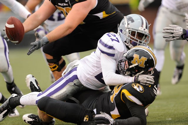 Missouri wide receiver T.J. Moe, bottom right, fumbles the ball as he is hit by Kansas State cornerback David Garrett, top right, while Missouri's Dan Hoch, left, recovers the ball on Saturday, Nov. 13, 2010, in Columbia, Mo. (AP Photo/L.G. Patterson)