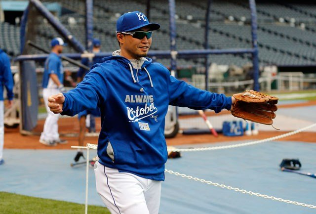 Kansas City Royals right fielder Norichika Aoki takes the field as his team works out on their off day in Kansas City on Sunday. The Royals are to face the Baltimore Orioles in Game 3 of the ALCS Monday. (AP Photo/Orlin Wagner)