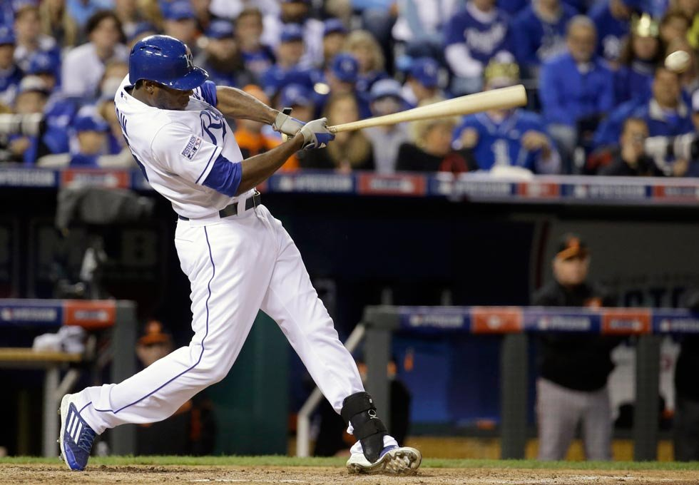 Kansas City Royals' Lorenzo Cain hits a single during the fourth inning of Game 3 of the American League baseball championship series against the Baltimore Orioles Tuesday, Oct. 14, 2014, in Kansas City, Mo. (AP Photo/Charlie Riedel)