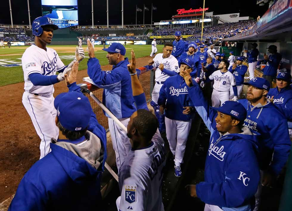 Kansas City Royals' Jarrod Dyson (1) is congratulated after scoring on a sacrifice fly by Billy Butler during the sixth inning of Game 3 of the American League baseball championship series against the Baltimore Orioles Tuesday. (AP Photo/Charlie Riedel)