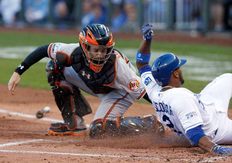 Kansas City Royals' Alcides Escobar scores ahead of the tag from Baltimore Orioles catcher Caleb Joseph during the first inning of Game 4 of the American League baseball championship series Wednesday (AP)