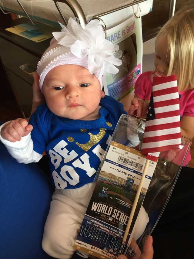 Baby Ali with her parents' World Series Game 1 tickets