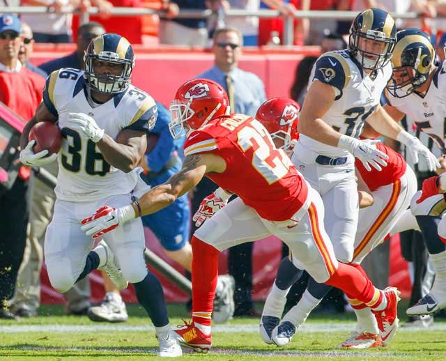 St. Louis Rams running back Benny Cunningham (36) runs from Kansas City Chiefs defensive back Kurt Coleman (27) in the first half of an NFL football game in Kansas City, Mo., Sunday, Oct. 26, 2014. (AP Photo/Colin E. Braley)