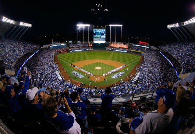 Spectators applaud as fireworks go off in Kauffman Stadium before Game 1 of baseball's World Series between the Kansas City Royals and the San Francisco Giants Tuesday, Oct. 21, 2014, in Kansas City, Mo. (AP Photo/Orlin Wagner)