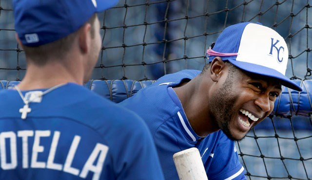 Kansas City Royals' Lorenzo Cain, right, talks with Johnny Giavotella during baseball practice Friday, Oct. 17, 2014, in Kansas City, Mo. (AP Photo/Charlie Riedel)