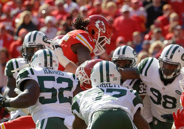 Kansas City Chiefs running back Jamaal Charles (25) leaps to score a touchdown in the first half of an NFL football game against the New York Jets in Kansas City, Mo., Sunday, Nov. 2, 2014. (AP Photo/Charlie Riedel)
