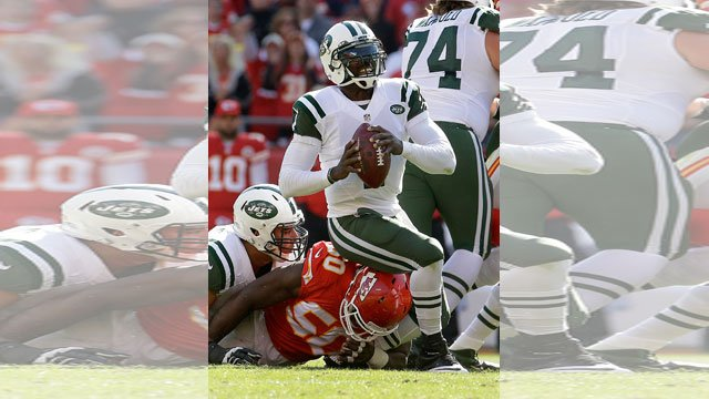 New York Jets quarterback Michael Vick (1) is sacked by Kansas City Chiefs outside linebacker Justin Houston (50) during the first half of an NFL football game, Sunday, Nov. 2, 2014, in Kansas City, Mo. (AP Photo/Charlie Riedel)