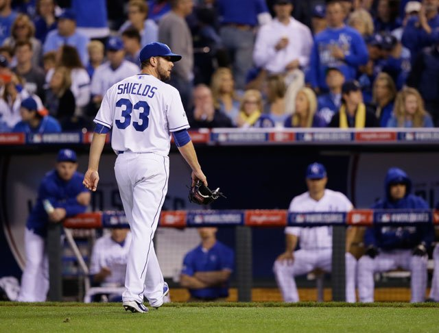 Kansas City Royals pitcher James Shields walks off the field after being relieved by Danny Duffy after giving four runs during the fourth inning of Game 1 of baseball's World Series Tuesday, Oct. 21, 2014, in Kansas City, Mo. (AP Photo/Charlie Neibergall)