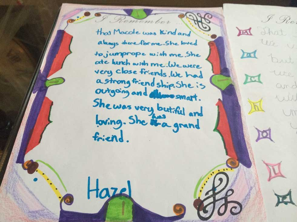 Machole's 4th grade classmates sent her letters that fill the family's dining room table.