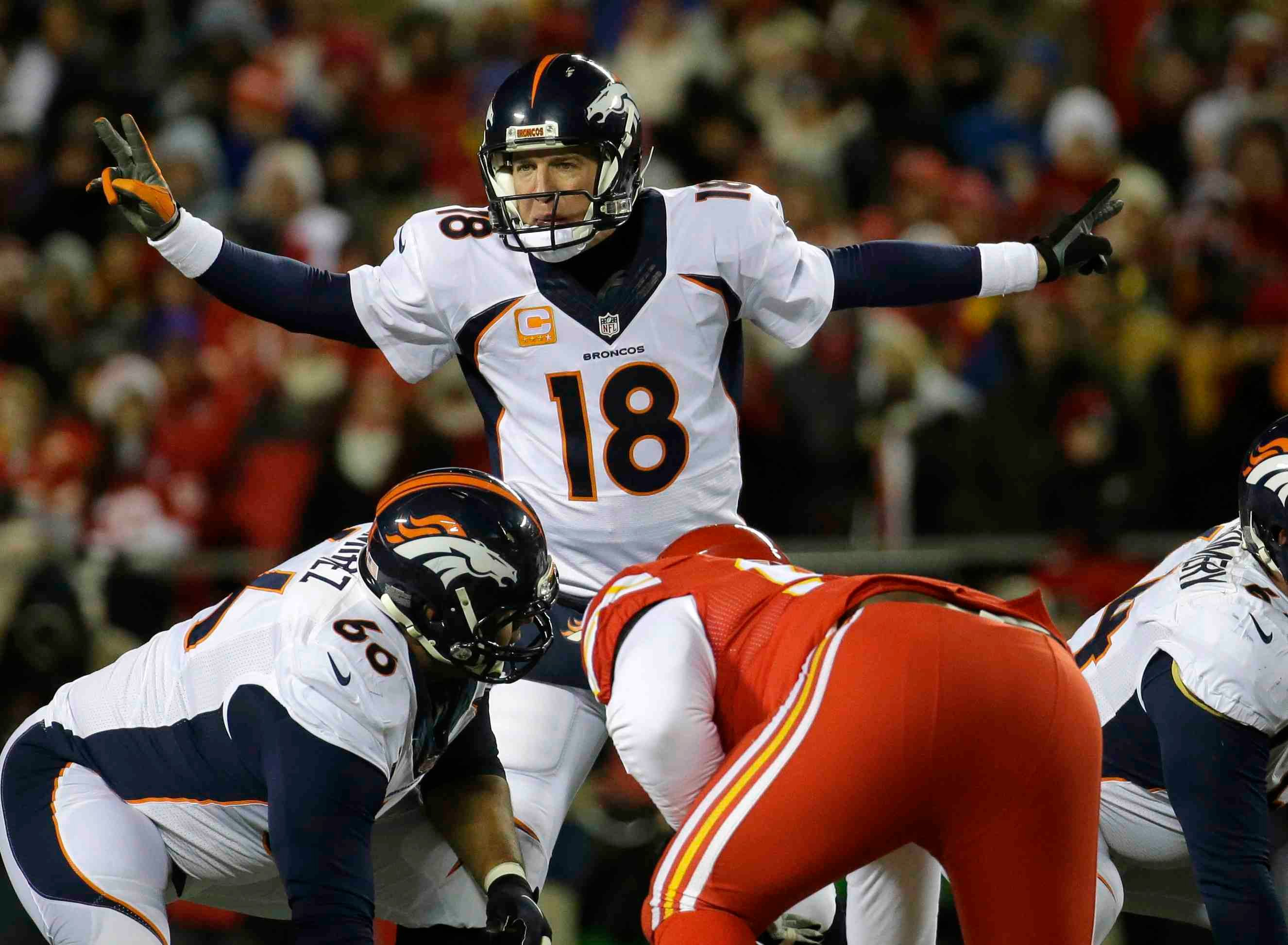 Peyton Manning leads Broncos offense against Chiefs at Arrowead Sunday night (AP)