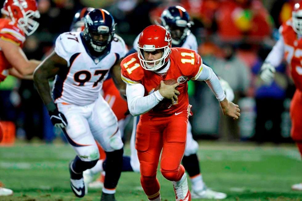 Kansas City Chiefs QB Alex Smith (11) runs away from Denver DE Malik Jackson (97) at Arrowhead Sunday night (AP)