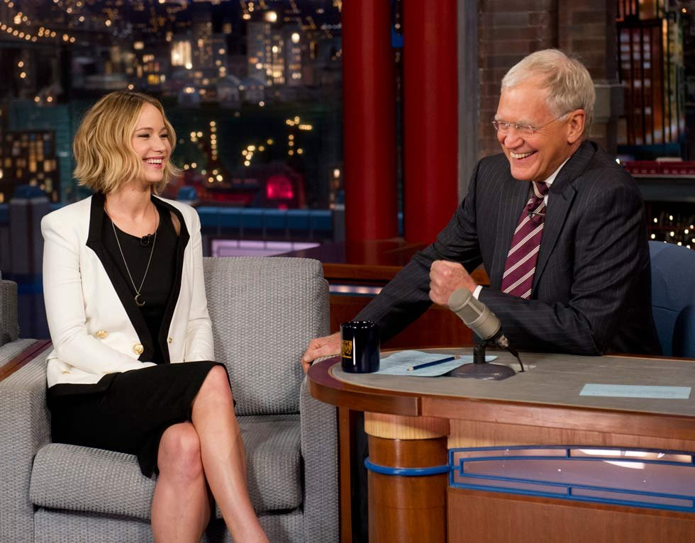 "In this photo provided by CBS, actress Jennifer Lawrence talks with host David Letterman on the set of the ""Late Show with David Letterman,"" Wednesday, Nov. 12, 2014 in New York. (AP Photo/CBS, Jeffrey R. Staab)"