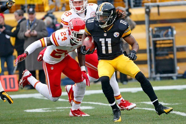 Pittsburgh Steelers wide receiver Markus Wheaton (11) runs after taking a pass from quarterback Ben Roethlisberger with Kansas City Chiefs defensive back Kelcie McCray (24) in pursuit during the first half in Pittsburgh on Sunday. (AP Photo/Tom Puskar)