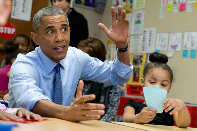 President Barack Obama visits with 3-5 year-olds at the Community Children's Center in Lawrence, Kansas, Thursday, Jan. 22, 2015, before speaking about the themes in his State of the Union address. Akira Cooper is at right. (AP Photo/Carolyn Kaster)
