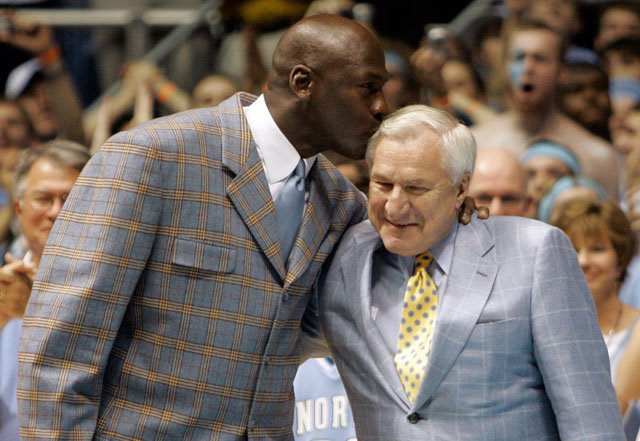 Former North Carolina player Michael Jordan, left, gives his former coach Dean Smith a kiss during halftime of a college basketball in Chapel Hill, N.C., Feb. 10, 2007. Jordan was a member of the 1982 team. (AP Photo/Gerry Broome)