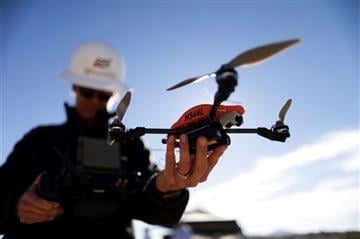 Long-anticipated rules proposed Sunday will open an era in which small (under 55 pounds) commercial unmanned aircraft perform routine tasks. (AP Photo/Gregory Bull, File)