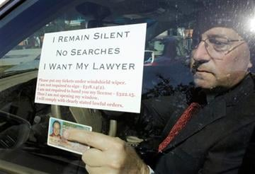 In this Friday, Jan. 30, 2015 photo, attorney Warren Redlich holds up a flyer he designed following an interview in Delray Beach, FL. (AP Photo/Lynne Sladky)