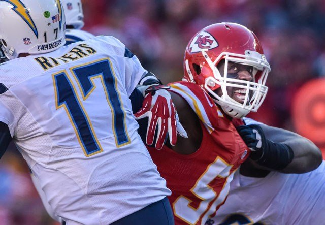 Justin Houston rushes San Diego Chargers quarterback Philip Rivers (17) during the second half of their NFL football game in Kansas City, Mo., Sunday, Dec. 28, 2014. (AP Photo/Reed Hoffmann)