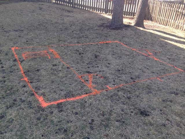 Orange paint marks outlines of where Ella's playhouse will go