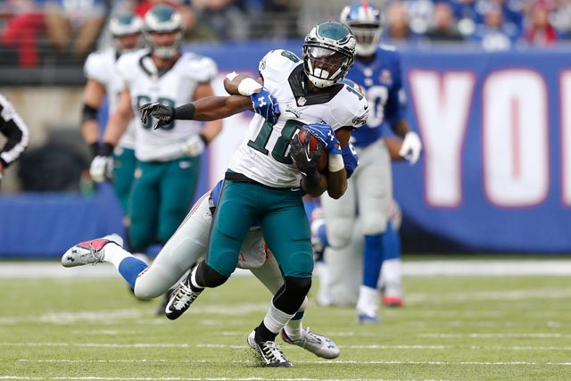 Philadelphia Eagles' Jeremy Maclin (18) is tackled by New York Giants' Dominique Rodgers-Cromartie (21) during the first half of an NFL football game Sunday, Dec. 28, 2014, in East Rutherford, N.J. (AP Photo/Julio Cortez)