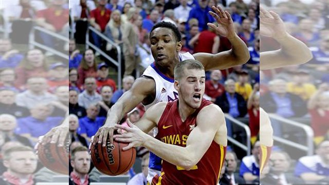 Kansas' Devonte Graham, back, tries to steal the ball from Iowa State's Matt Thomas during the first half of an NCAA college basketball game in the finals of the Big 12 Conference tournament Saturday. (AP Photo/Charlie Riedel)