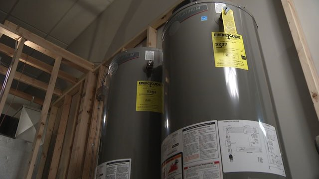 Most current water heaters under the Department of Energy's new efficiency requirements are not good enough, and buying another one means it will be bigger.