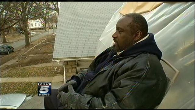 Tony Caldwell camping out on a rooftop to draw attention to the lack of affordable housing.