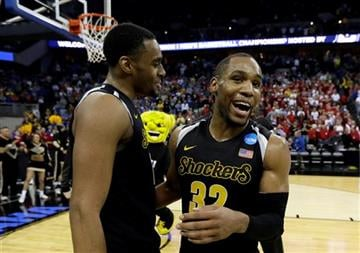 Wichita State guard Tekele Cotton, right, celebrates with teammate Darius Carter after an NCAA college basketball tournament Round of 32 game against Kansas, Sunday, March 22, 2015, in Omaha, Neb. Wichita State won 78-65. (AP Photo/Charlie Neibergall)