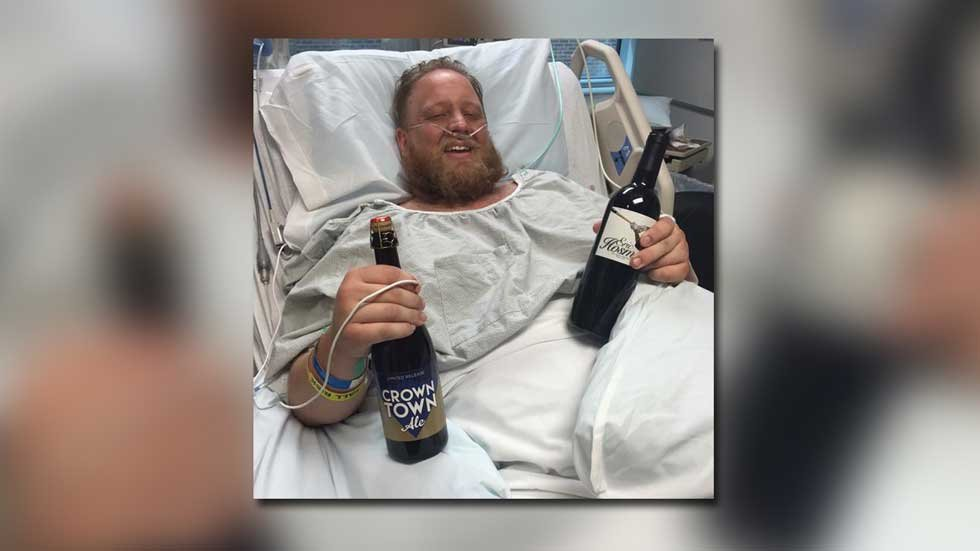 Jimmy Faseler with a bottle of Crown Ale while in the hospital