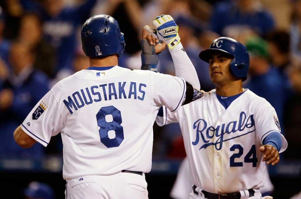 Kansas City Royals' Mike Moustakas (8) is congratulated by teammate Christian Colon (24) after his two-run home run in the fifth inning of a baseball game against the Minnesota Twins at Kauffman Stadium in Kansas City, Tuesday. (AP Photo/Orlin Wagner)
