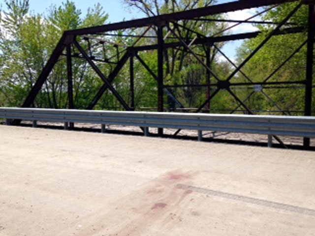 Authorities said a large blood stain was visible on the bridge, along with blood droplets on the bridge's north side rail. (Eric Smith/KCTV5 News)