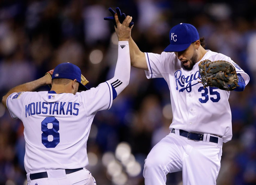 Royals third baseman Mike Moustakas (8) and first baseman Eric Hosmer (35) celebrate following a baseball game against the Detroit Tigers at Kauffman Stadium in Kansas City, MO, Thursday. The Royals defeated the Tigers 8-1. (AP Photo/Orlin Wagner)
