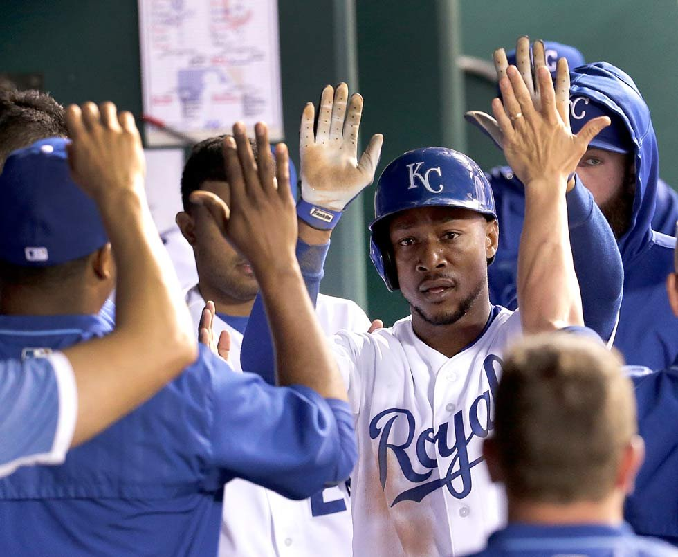 Kansas City Royals' Jarrod Dyson celebrates in the dugout after scoring on a single by Alex Gordon during the fifth inning of a baseball game against the Cleveland Indians, Tuesday, May 5, 2015, in Kansas City, Mo. (AP Photo/Charlie Riedel)