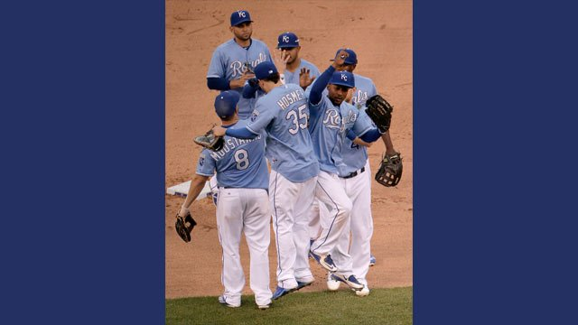 Players for the Kansas City Royal celebrate after their baseball game against the Cleveland Indians, Thursday, May 7, 2015, in Kansas City, Mo. The Royals won 7-4. (AP Photo/Charlie Riedel)