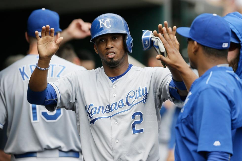 Kansas City Royals' Alcides Escobar is congratulated in the dugout after scoring during the second inning of a baseball game against the Detroit Tigers, Saturday, May 9, 2015, in Detroit. (AP Photo/Carlos Osorio)