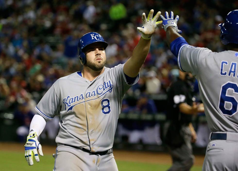 Kansas City Royals Mike Moustakas (8) gets a congrats from teammate Lorenzo Cain (6) after Moustakas hit a solo home run during the seventh inning of a baseball game against the Texas Rangers in Arlington, Texas, Tuesday, May 12. (AP Photo/LM Otero)