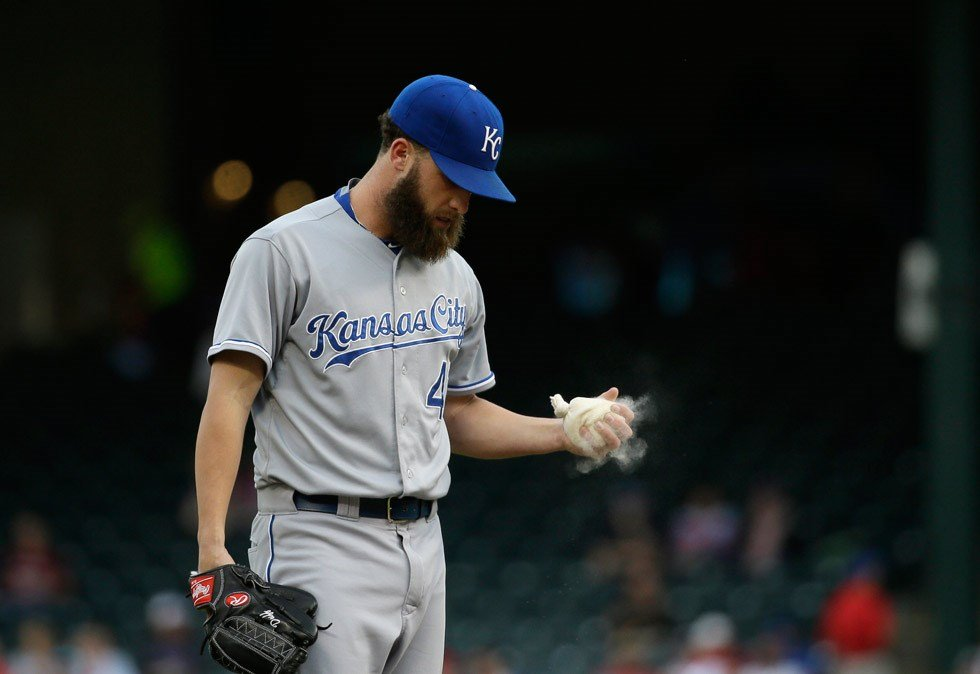 Kansas City Royals starting pitcher Danny Duffy grabs the rosin bag during the first inning of a baseball game against the Texas Rangers in Arlington, Texas, Monday, May 11, 2015. (AP Photo/LM Otero)