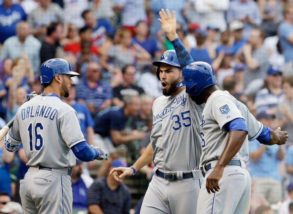Royals' Eric Hosmer, center, & Lorenzo Cain, right, celebrate with Paulo Orlando after they scored on a fielding error by Cubs center fielder Dexter Fowler during the 8th inning of an interleague baseball game Friday in Chicago (AP Photo/Nam Y. Huh)