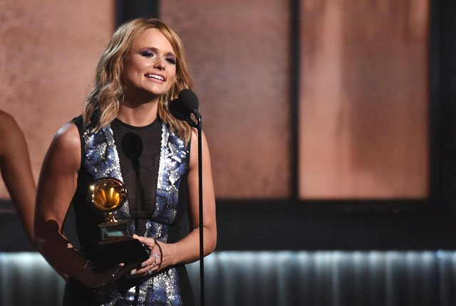 """Miranda Lambert accepts the award for best country album for """"Platinum"""" at the 57th annual Grammy Awards on Sunday, Feb. 8, 2015, in Los Angeles. (Photo by John Shearer/Invision/AP)"""