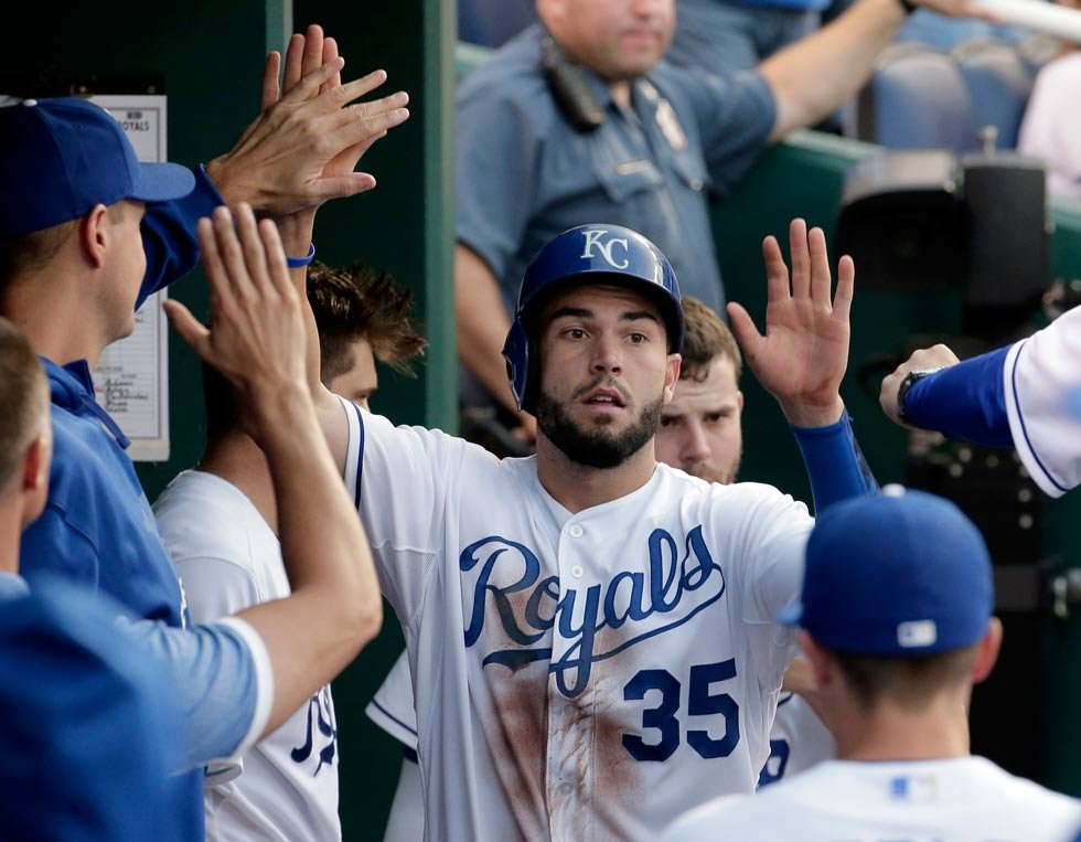 Kansas City Royals' Eric Hosmer (35) celebrates in the dugout after scoring on a double by Kendrys Morales during the third inning of a baseball game against the Cleveland Indians on Wednesday, June 3, 2015, in Kansas City, Mo. (AP Photo/Charlie Riedel)