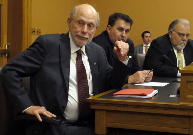 Kansas Senate Assessment and Taxation Committee Chairman Les Donovan, left, R-Wichita, follows a discussion of tax issues during a meeting of GOP senators, Saturday, June 6, 2015, at the Statehouse in Topeka, Kan. (AP Photo/John Hanna)