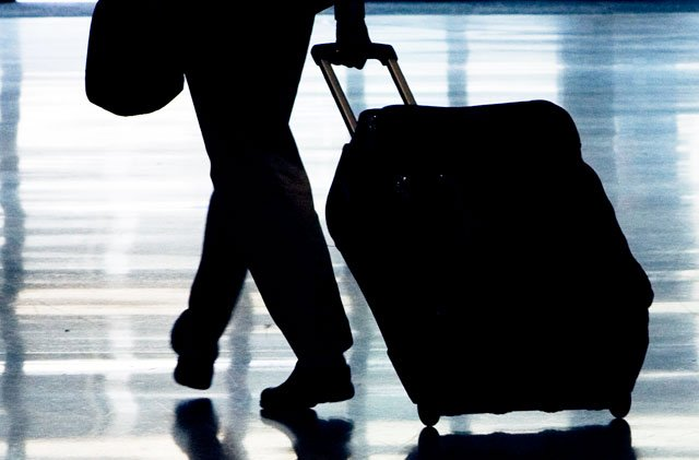 Global airlines announced Tuesday a new guideline that recommends shrinking carry-on bags, in an effort to free up space in packed overhead bins. (AP, File)