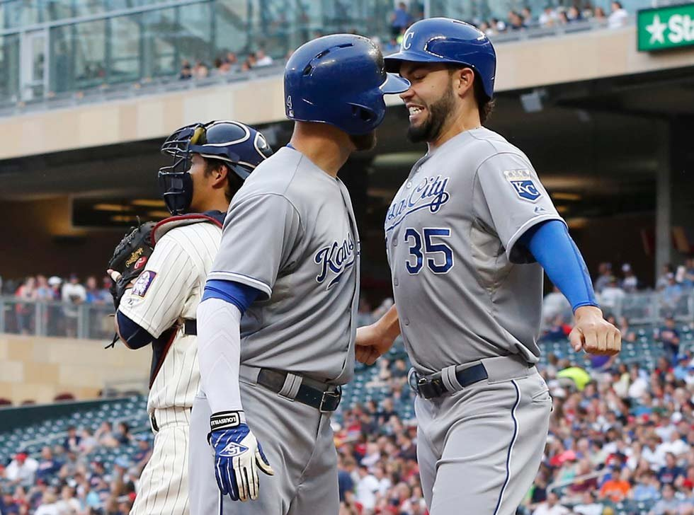 Royals' Alex Gordon, left, and Eric Hosmer bump chests after Gordon's three-run home run off Minnesota Twins pitcher Kyle Gibson during the 1st inning of the game June 10 in Minneapolis. (AP Photo/Jim Mone)