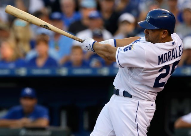 Kansas City Royals designated hitter Kendrys Morales hits a two-run home run off Boston Red Sox starting pitcher Rick Porcello during the fifth inning of a baseball game at Kauffman Stadium in Kansas City on Saturday. (AP Photo/Orlin Wagner)