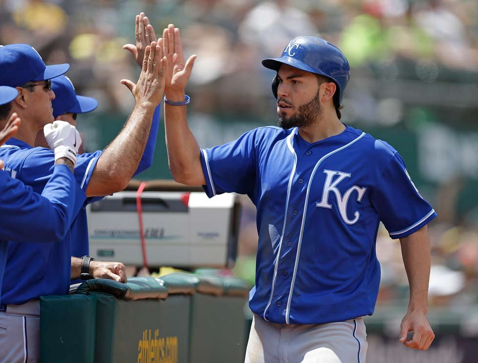 Kansas City Royals' Eric Hosmer, right, celebrates after scoring against the Oakland Athletics in the sixth inning of a baseball game Saturday, June 27, 2015, in Oakland, Calif. Hosmer scored on a single by Royals' Kendrys Morales. (AP Photo/Ben Margot)