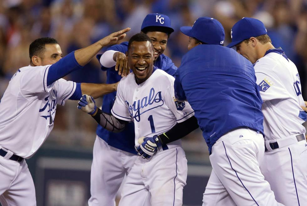 Royals' Jarrod Dyson (1) is mobbed by teammates after driving in the winning run during the 10th inning of a baseball game against the Minnesota Twins at Kauffman Stadium Friday, July 3. The Royals defeated the Twins 3-2. (AP Photo/Orlin Wagner)