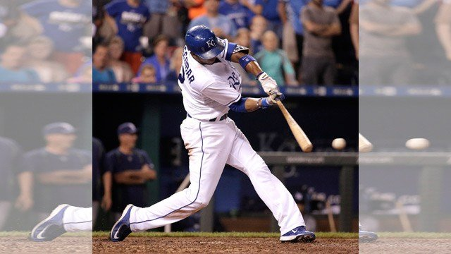 Kansas City Royals' Alicdes Escobar hits a three-run double during the sixth inning of the second game in a baseball doubleheader against the Tampa Bay Rays on Tuesday, July 7, 2015, in Kansas City, Mo. (AP Photo/Charlie Riedel)