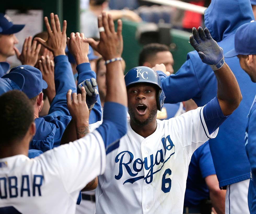 Kansas City Royals' Lorenzo Cain (6) celebrates in the dugout after hitting a two-run home run during the third inning of a baseball game against the Tampa Bay Rays on Wednesday, July 8, 2015, in Kansas City, Mo. (AP Photo/Charlie Riedel)